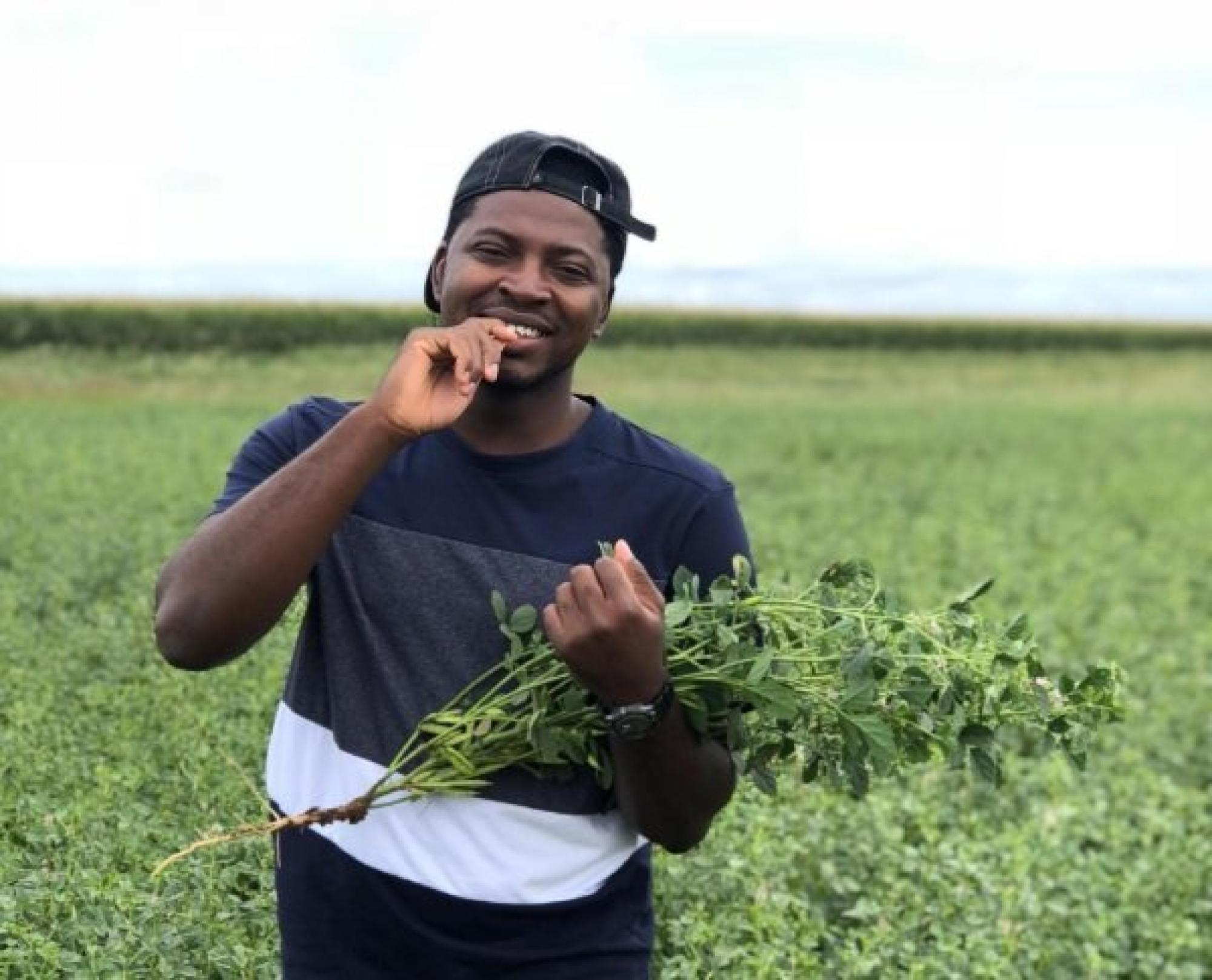 SBAR student – Meshack Audu – in a guar research field at the NMSU Agricultural Science Center in Clovis, New Mexico
