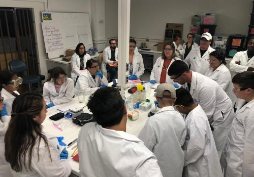 Craig Bal (UA Master's student in Education) leads students in a bioenergy lesson