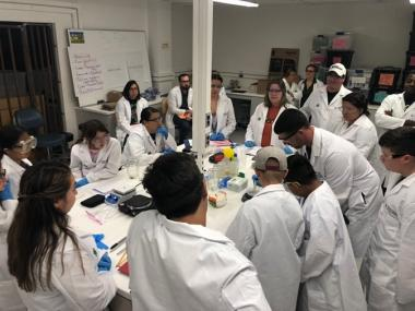 Craig Bal (UArizona Master's student in Education) leads students in a bioenergy lesson.